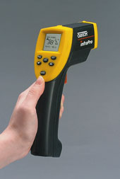 Figure 1: With an IR thermometer, the user points the instrument at the object and pulls the trigger to display the temperature.